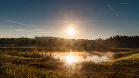 Reflections on the Water. Morning Landscape Shot at Chateau Seehof with sun reflections in the lake in Bavaria, Germany Royalty Free Stock Image