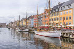 Reflections in the water of sailing vessels in Nyhavn harbor, Cope. Reflections in the water of fishing boats in Nyhavn harbor, Copenhagen, Denmark, June 15 Royalty Free Stock Photos