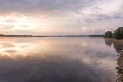 Reflections in water at sunrise by the river. Smoke on the water at sunrise by the river at the end of summer Royalty Free Stock Photography