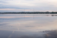 Reflections in water at sunrise by the river. Smoke on the water at sunrise by the river at the end of summer Stock Photography