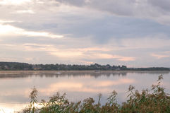Reflections in water at sunrise by the river. Smoke on the water at sunrise by the river at the end of summer Royalty Free Stock Photo
