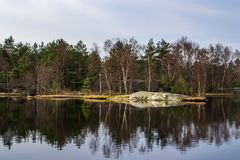 Reflections on the water surface on a calm lake. royalty free stock photos