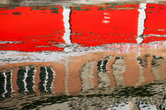 Reflections on water. Water surface with multicolor reflections Stock Image