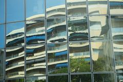 Reflections in windows. Image of a hotel reflected in the opposite building windows. Monte Carlo, Monaco Royalty Free Stock Images