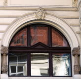Reflections in windows of a building on Perla street Stock Photo
