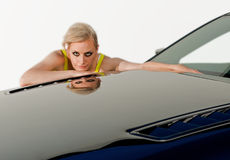 Reflections of a woman in shiny new car Royalty Free Stock Image