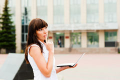 Reflections on the work. Business woman pondered over the problem Royalty Free Stock Photos