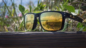 Reflections of zen. A pair of sunglasses with a North Carolina beach can be seen reflecting off the lenses Stock Images