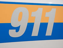 Reflective 911 -decal. On side of a law enforcement vehicle Royalty Free Stock Images