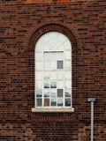 Reflective arched window Stock Image
