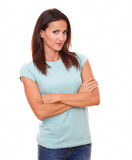 Reflective attractive lady smiling at you. Portrait of reflective 30-34 years lady on blue t-shirt with crossed arms smiling at you on isolated studio Stock Photos