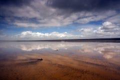 Reflective beach scene at Westward Ho!. Magnificent and reflective beach at Westward Ho in North Devon , England Stock Photos