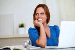 Reflective beautiful student woman smiling Royalty Free Stock Photo