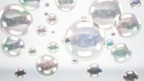 Reflective Bubbles or Spheres over Bright Background Royalty Free Stock Photos