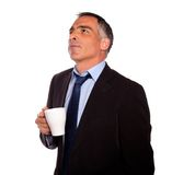 Reflective business man with a white mug Stock Photos