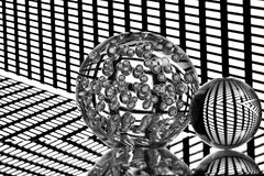 Reflective clear glass balls on grid Royalty Free Stock Photo