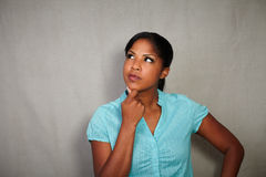 Reflective female contemplating while looking away. Reflective female in blue blouse contemplating while looking away - copy space Royalty Free Stock Images
