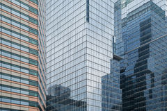 Reflective glassy walls on office buildings. Skyscrapers reflective glassy walls and reflections of another buildings on them in Seoul, South Korea royalty free stock image