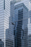 Reflective glassy walls on office buildings. Skyscrapers reflective glassy walls and reflections of another buildings on them in Seoul, South Korea stock photography