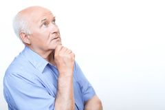 Reflective grandfather involved in thinking Royalty Free Stock Photos