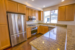Reflective granite counter in townhouse. Model home kitchen in southern California ready for a real estate shoot Stock Image