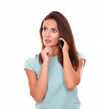 Reflective hispanic woman talking on her cell Royalty Free Stock Images