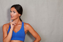 Reflective lady with finger on chin Royalty Free Stock Photography