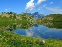 Reflective lake, Alpe d'Huez. Reflective lake near Alpe d'Huez, France Royalty Free Stock Photos