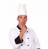 Reflective latin chef standing and looking away Royalty Free Stock Photo