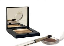 Reflective Makeup. Makeup compact taken with reflection of brush and colour in mirror Royalty Free Stock Photo