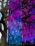 A reflective metal surface with cut-out crosses Royalty Free Stock Image