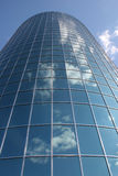 Reflective Office. Modern office building with reflections of blue sky and clouds Royalty Free Stock Images