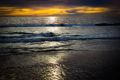 Reflective pacific ocean sunset from shore Stock Photo