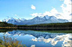 Reflective panorama of the Rockies Stock Images