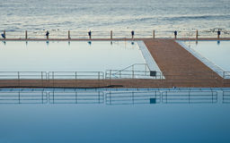 Reflective pool and sea Royalty Free Stock Images