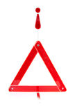 Reflective road hazard warning triangle. Foldaway reflective road hazard warning triangle isolated on a white background royalty free stock photography