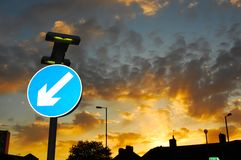 Reflective road sign set against dramatic early summer sky stock photos