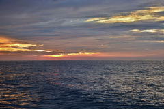 Reflective Seas Beneath Sunrise Stock Image