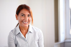 Reflective senior woman smiling at you Royalty Free Stock Photography