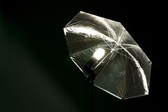 Reflective shiny umbrella with the included energy-saving lamp for shooting royalty free stock photos