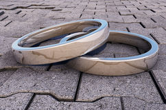 2 Reflective Silver Rings on a pavement. 2 Reflective Silver Rings on a road side pavement, great for ads and covers Stock Photography