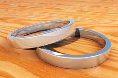 2 Reflective Silver Rings on a  wood plank Stock Photography