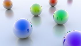 Reflective Spheres. Reflective colorful spheres on a flat ground Stock Images