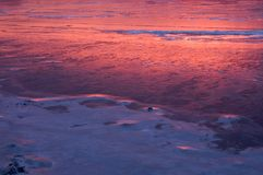 Reflective sunrise. Sunrise reflecting off icy river, Phila., Pa Stock Image