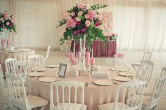 Slot with flowers at the wedding banquet Stock Photography