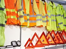 Reflective vests and plastic red emergency sign for car Royalty Free Stock Photos