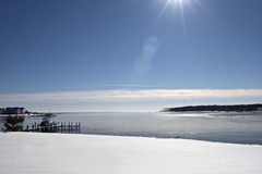 Reflective winter snow covered shore Stock Photo