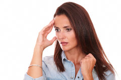Reflective young woman with headache looking down Royalty Free Stock Photo