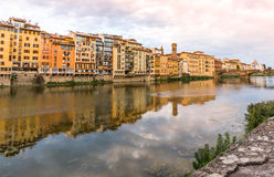 Reflecton in Arno river Florence, Italy. Houses and bridge on the Arno river with reflections royalty free stock image