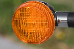 Reflector. Orange reflector on a motorcycle Stock Image